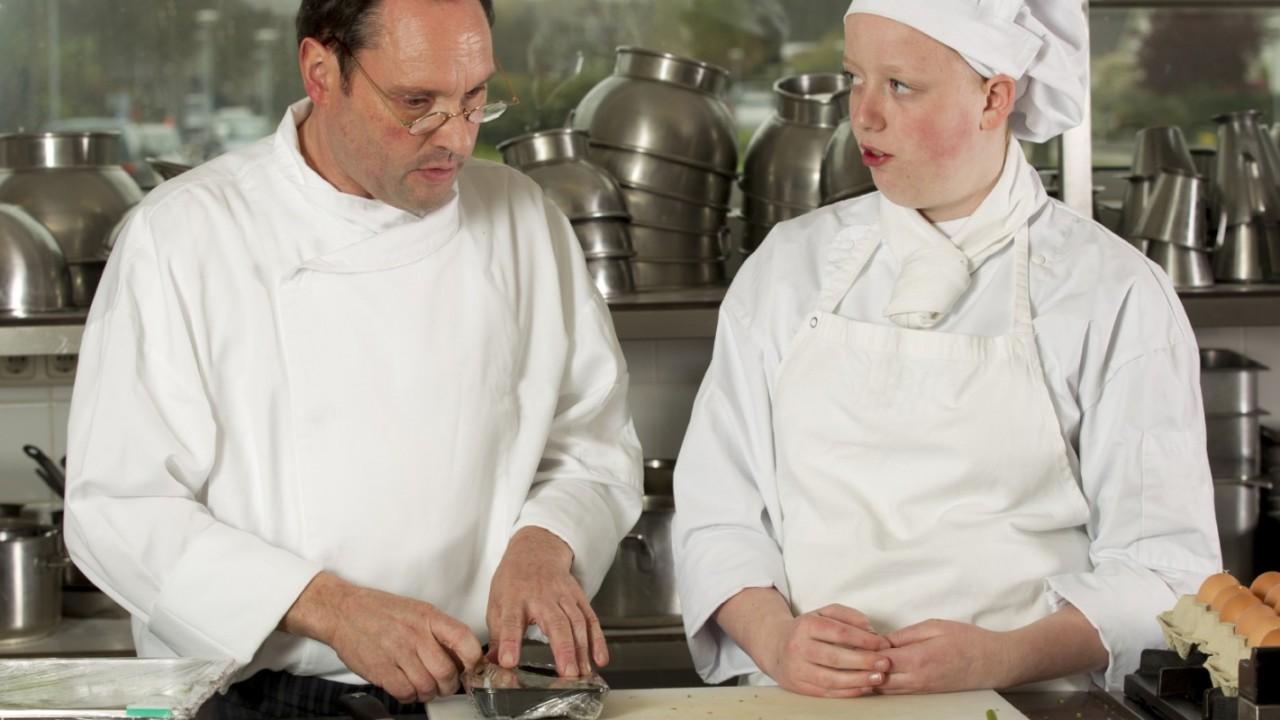 Photo of chefs in kitchen.