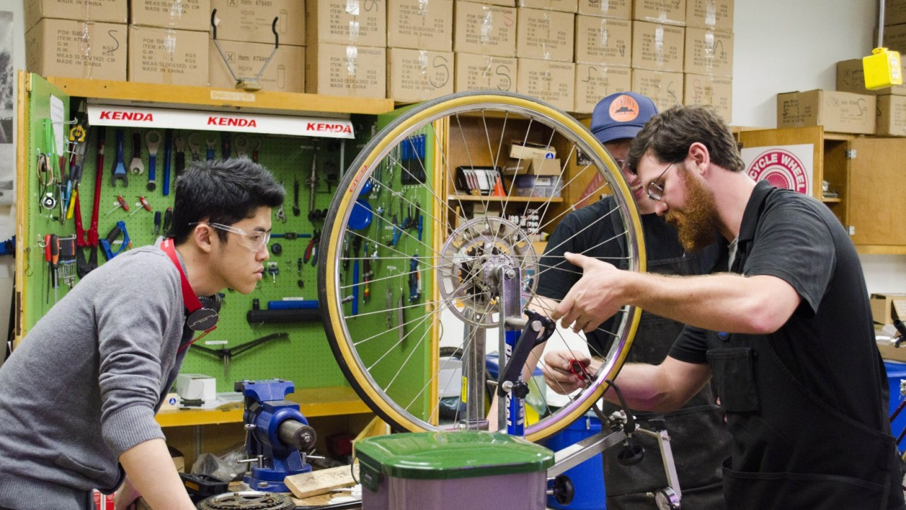people working in the open bike shop