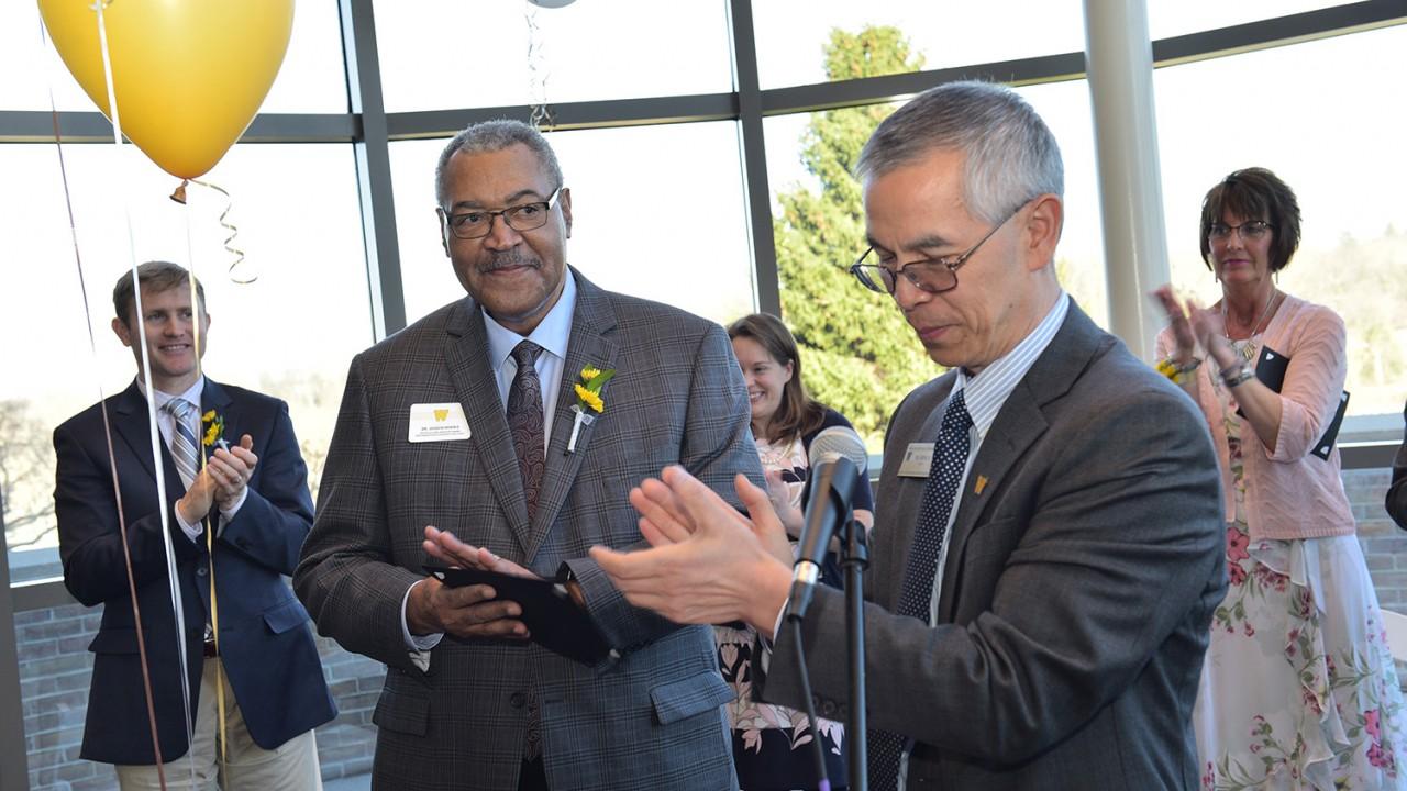 Joseph Morris receiving award from Dean Li
