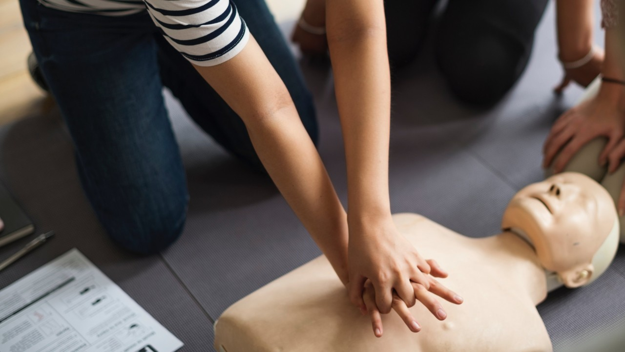 Students learning CPR on a dummy