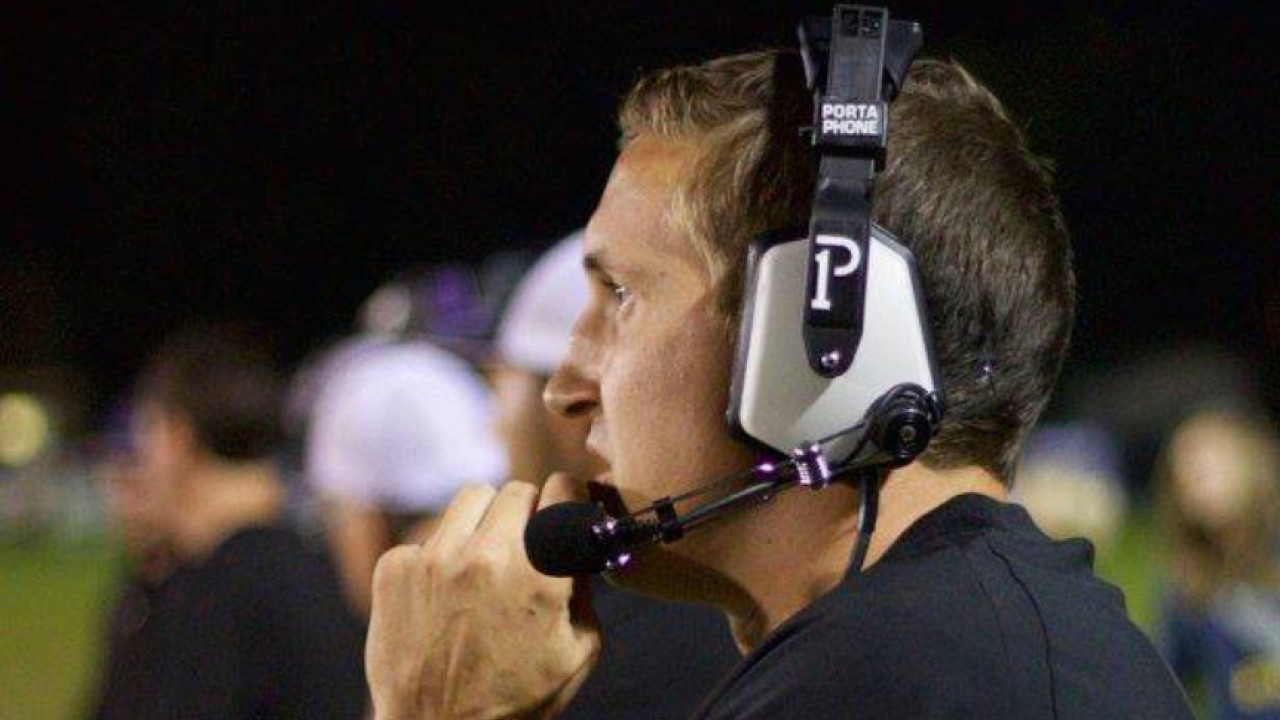 Vincent Church talking in headset during football game