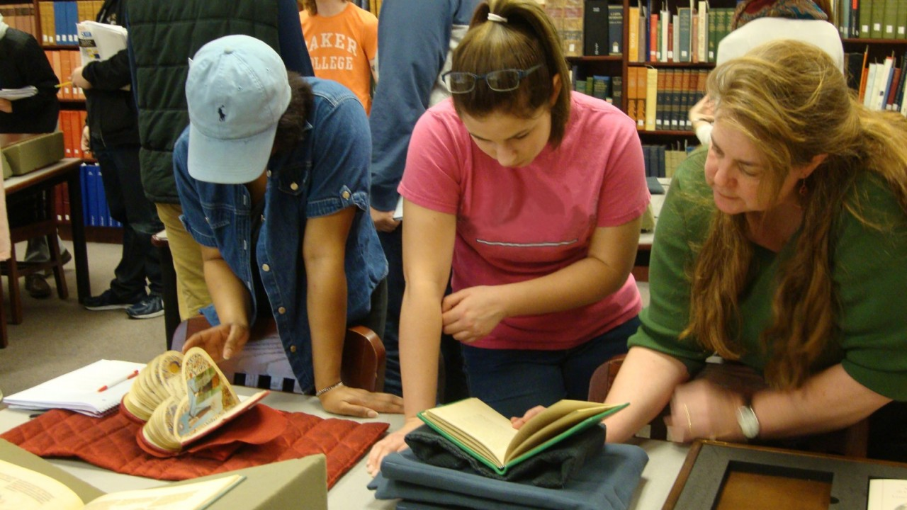 Students looking at books in Rare Book Room.