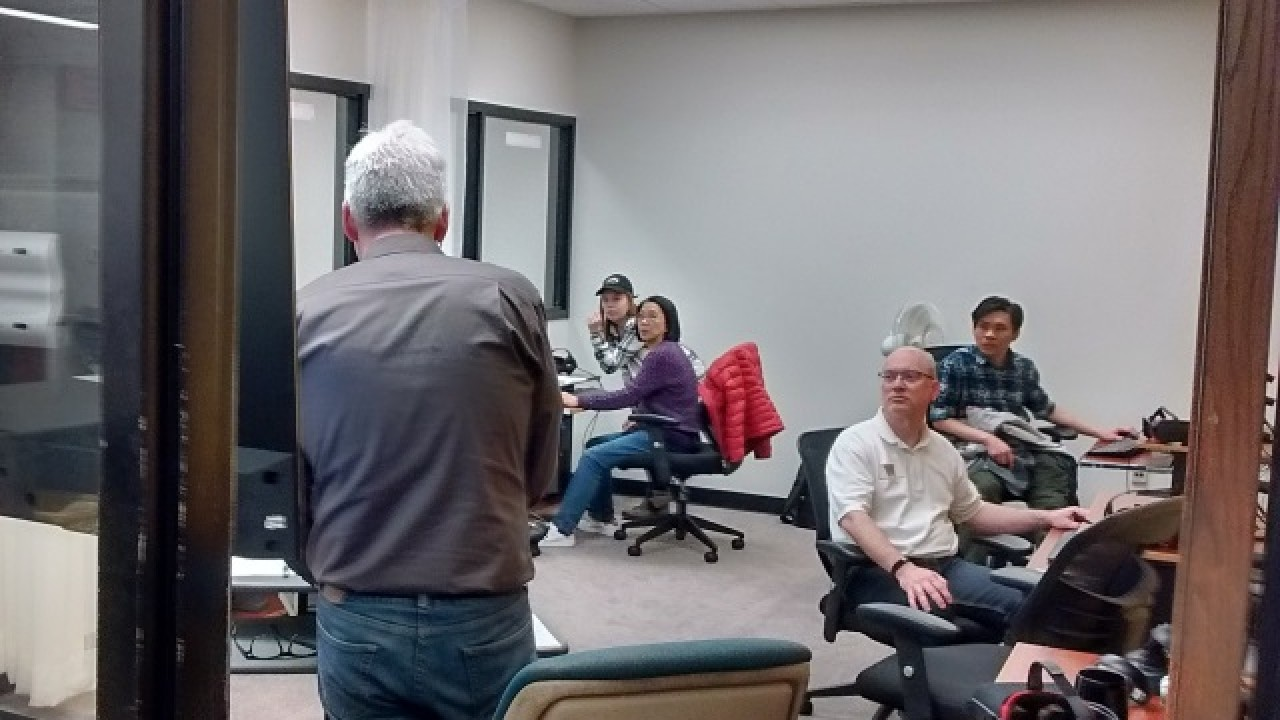 People sitting at desks during a virtual reality workshop.