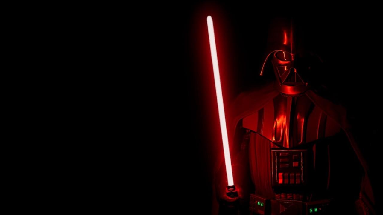 Darth Vader holding a red light saber.
