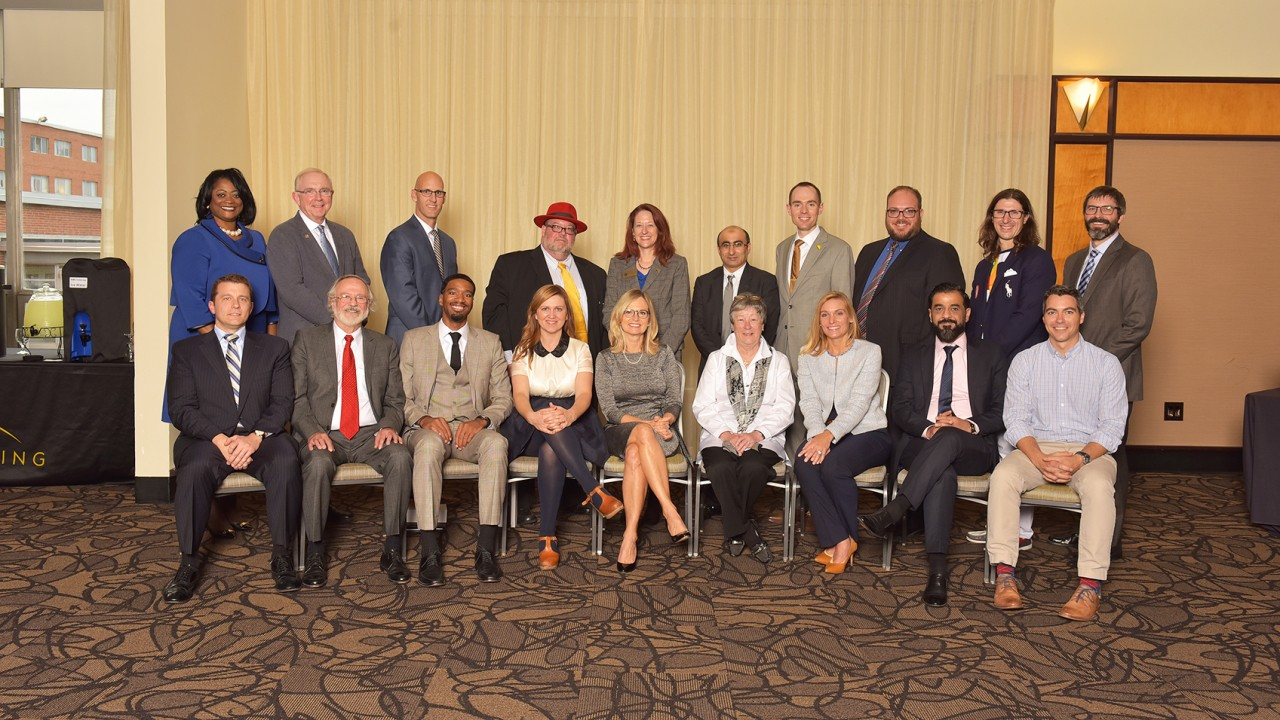 Group of eighteen alumni who received Alumni Achievement Awards in October