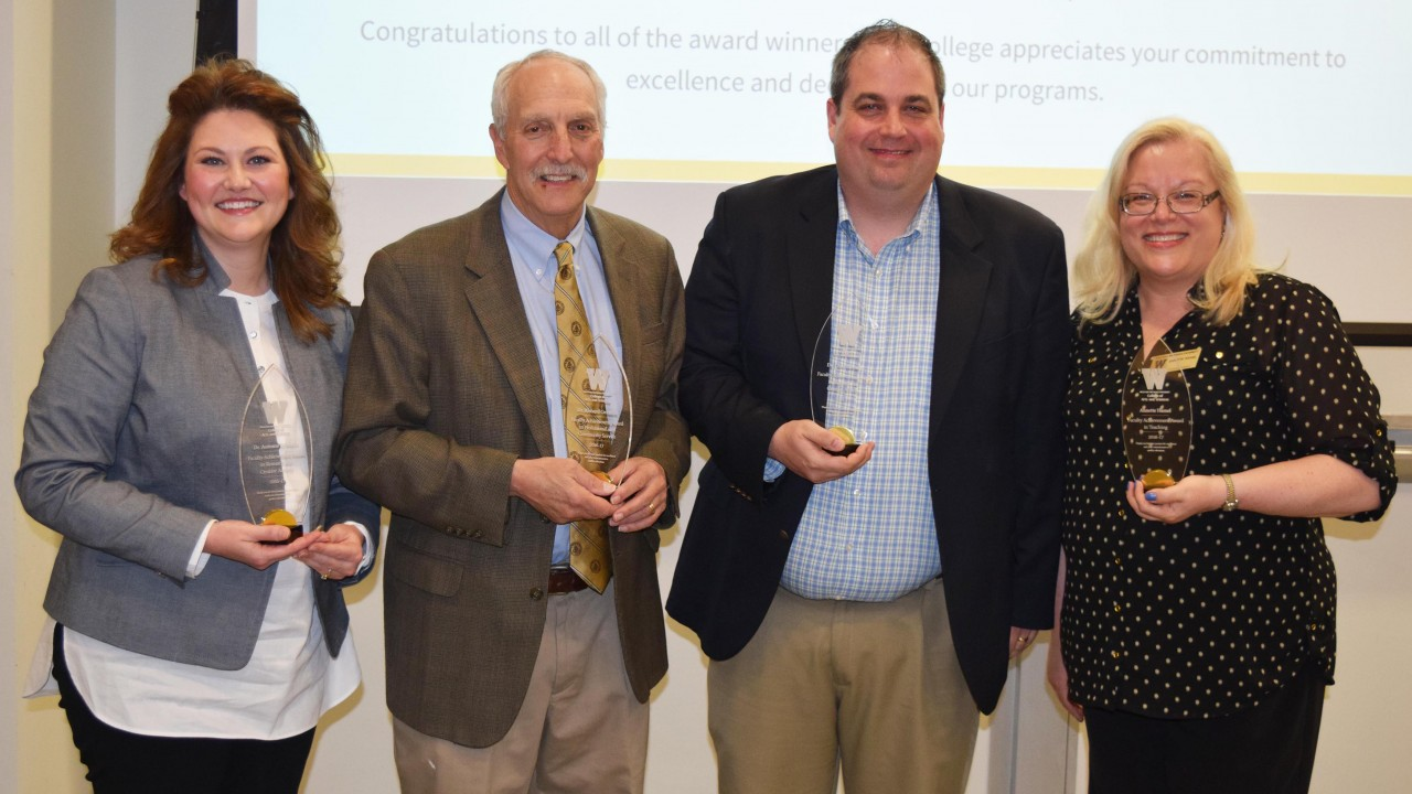 Faculty members wins faculty achievement awards