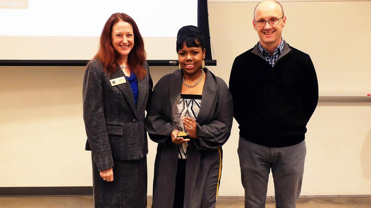 Dr. Carla Koretsky, award winner Dr. Perryman-Clark (holding plaque) and Dr. Nicolas Witschi