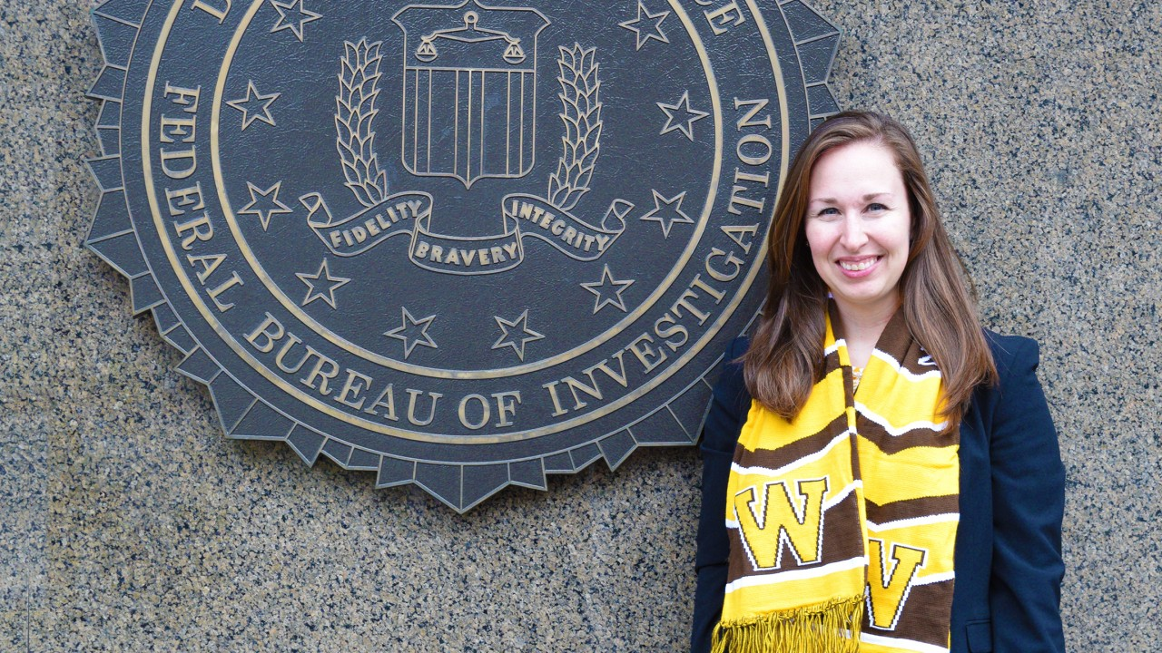 Emily Hawrysz stands in front of FBI building in Washington, DC