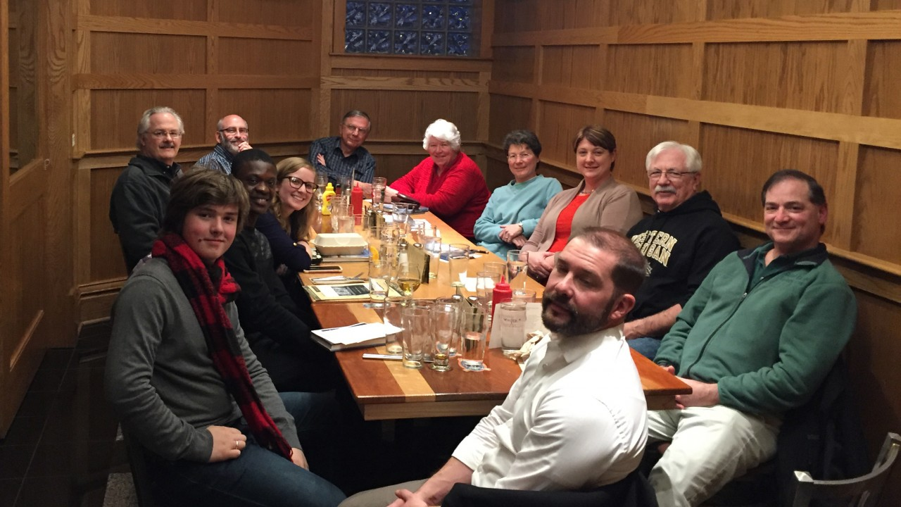 A group gathers at a restaurant for the book club