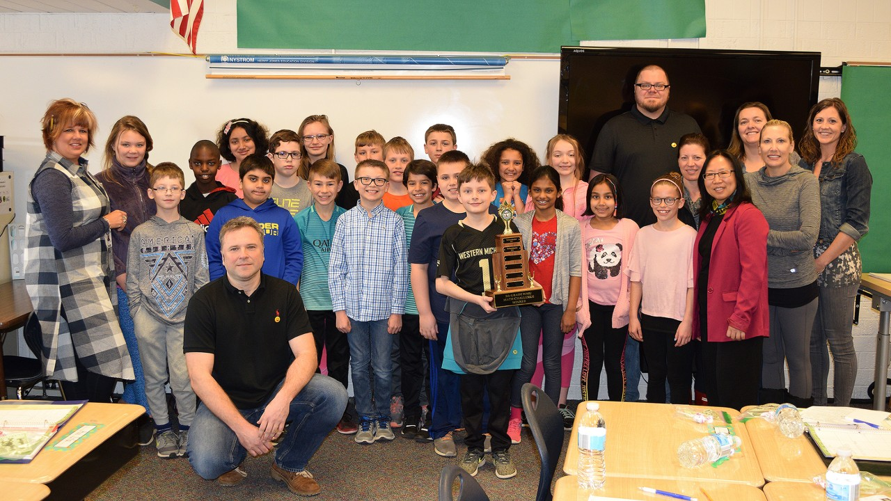 WMU professors pose with the fifth grade winning class.