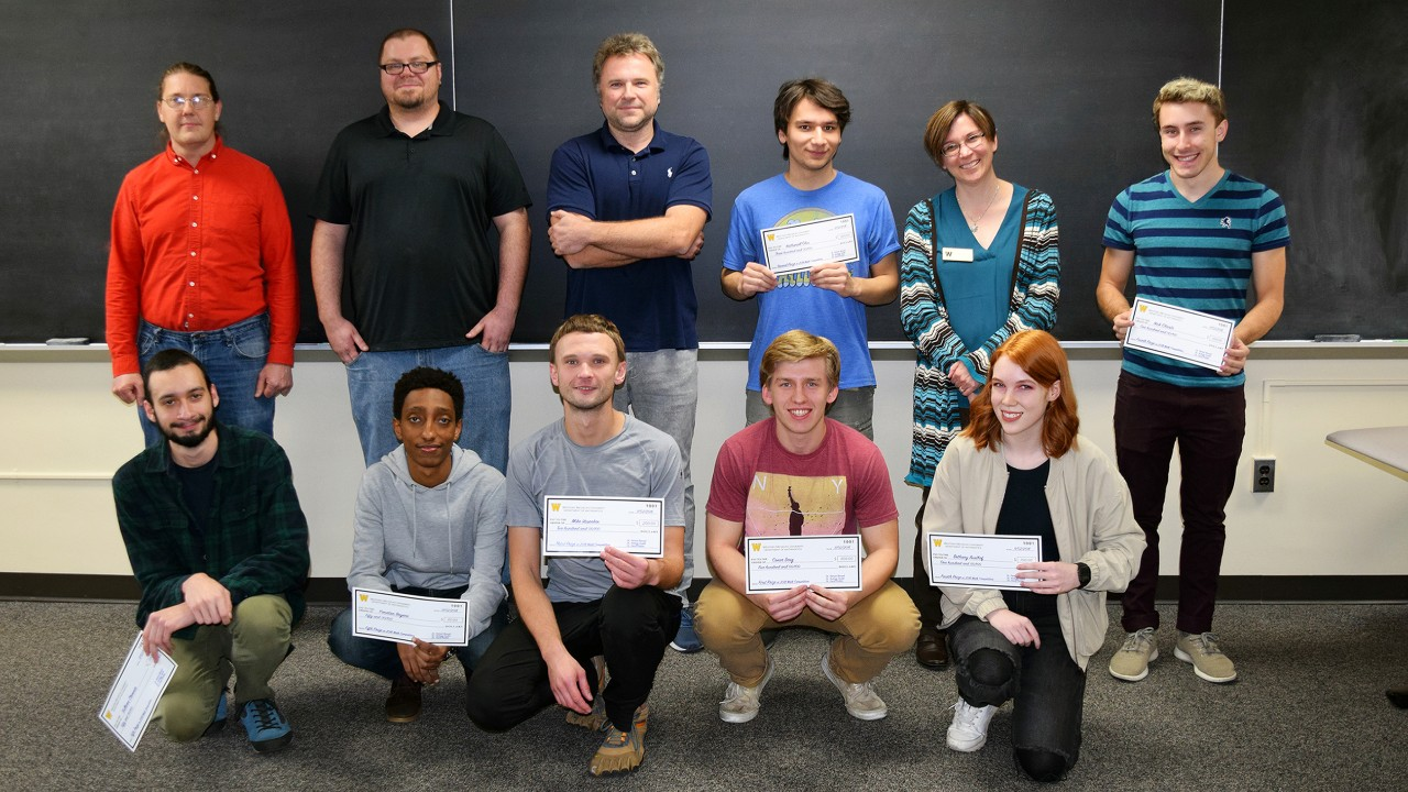 Math professors line up with competition winners