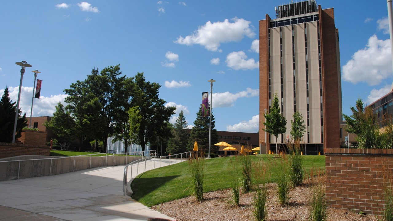 Picture of Sprau Tower on a sunny day, being shot from the side of Miller Auditorium