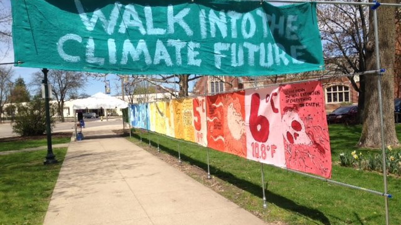 "A banner that reads ""Walk Into the Climate Future"""