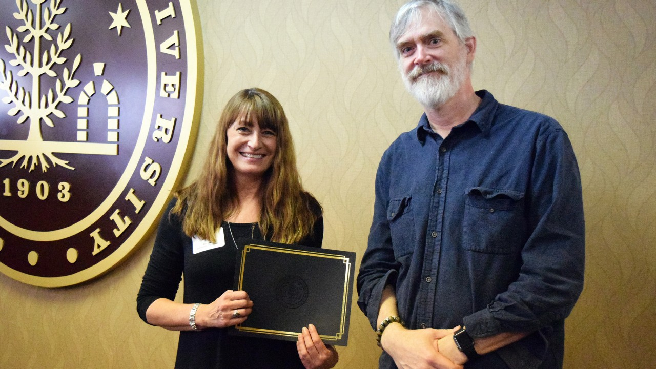 Lori Diehl poses with certificate and chair Dr. Steve Covell
