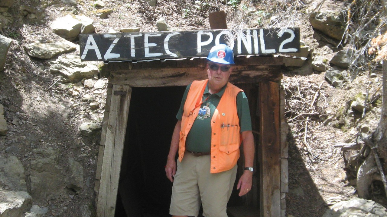 "Roger Steininger standing outside the mine ""Aztec Ponil 2"""