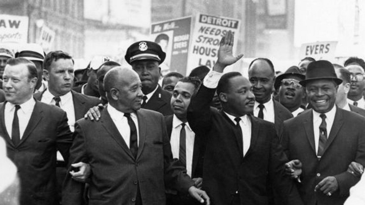 Martin Luther King Jr. marches with other people of color