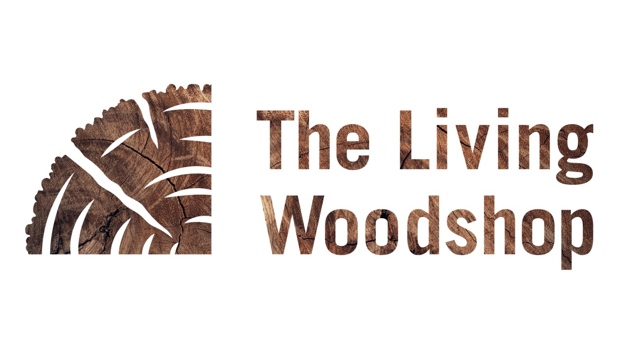 "Text says, ""The Living Woodshop"" - The text background is of a tree and a saw."