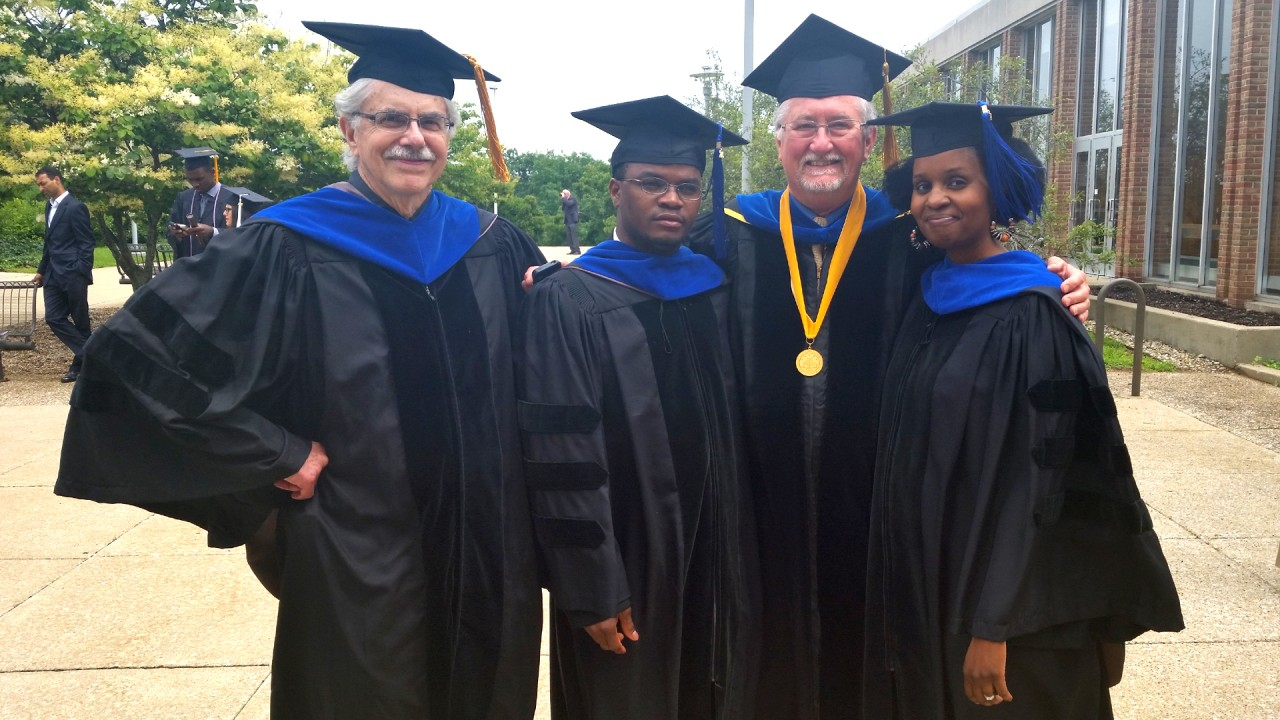 Doctoral graduates Taibu and Pennock with Professor Schuster and Professor Cobern