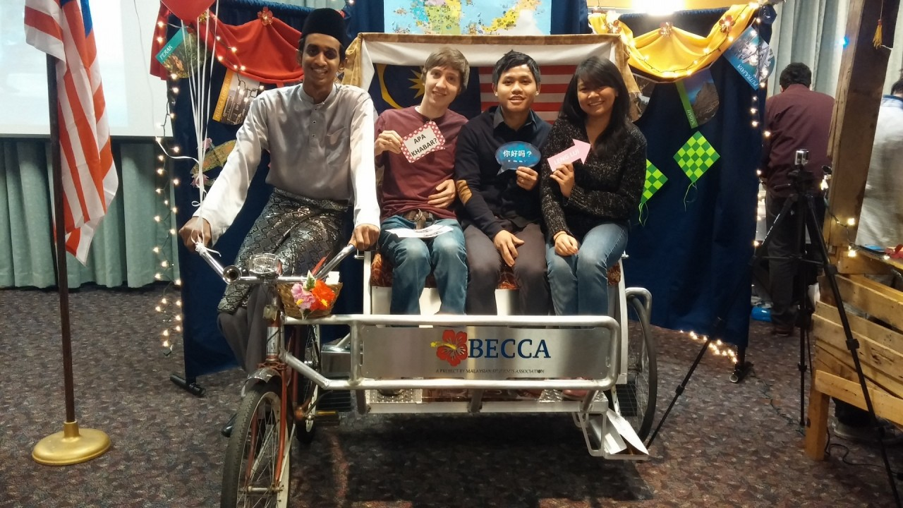 Peer mentor and mentees posing on a rickshaw.