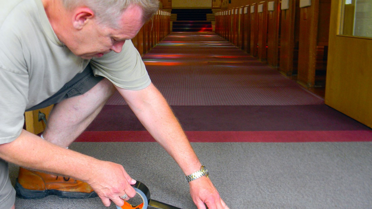 A custodian from dining helps get carpets ready for the fall semester