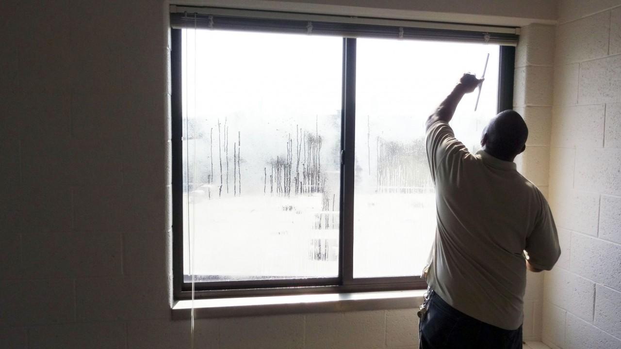 Washing windows in Moore Hall