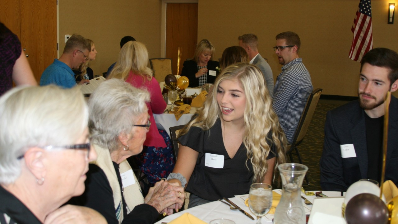Jean Friedel and Cassidy Davis sitting at the alumni awards luncheon