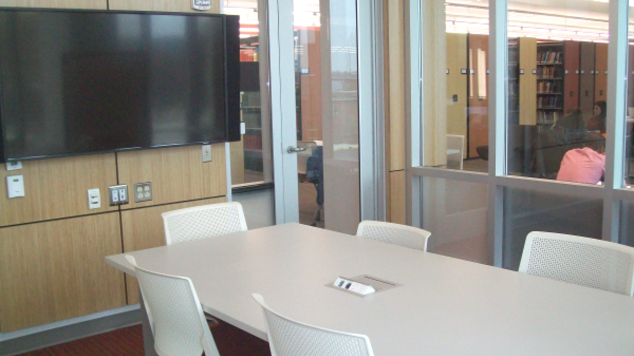 An empty Group Study Room with large screen display at Swain Education Library in Sangren Hall.