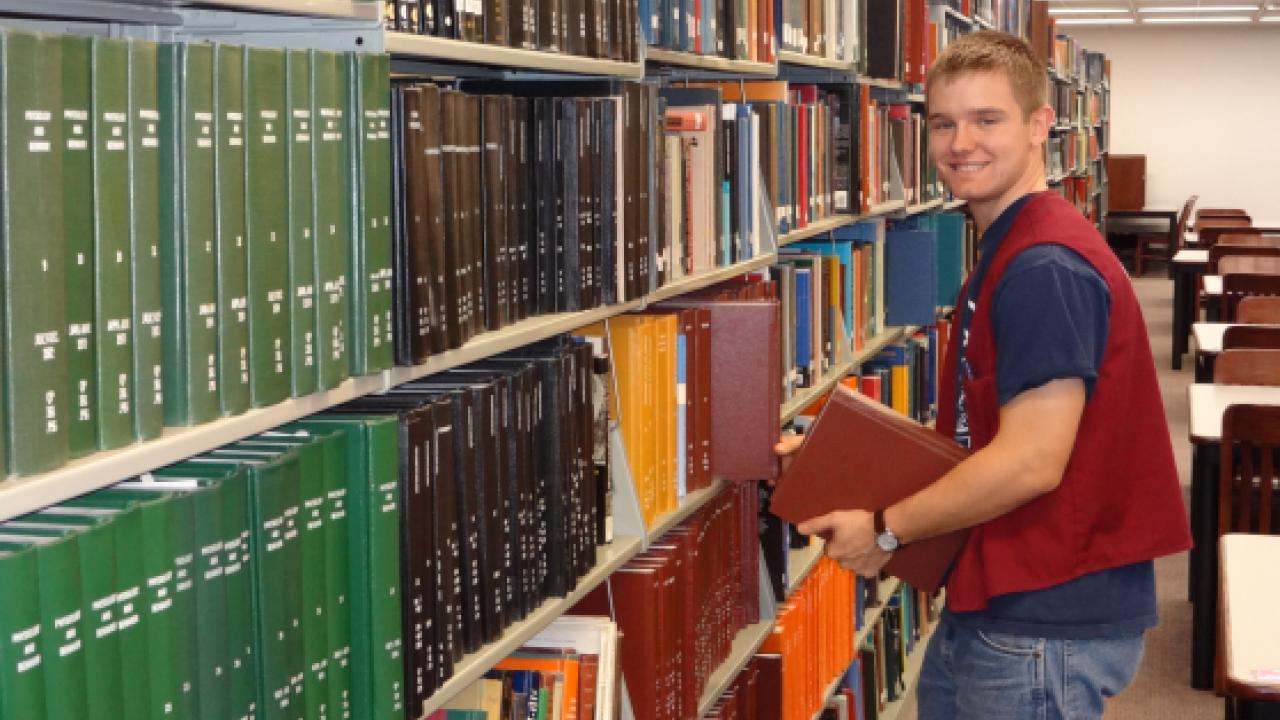 Stacks Student Employee shelving books