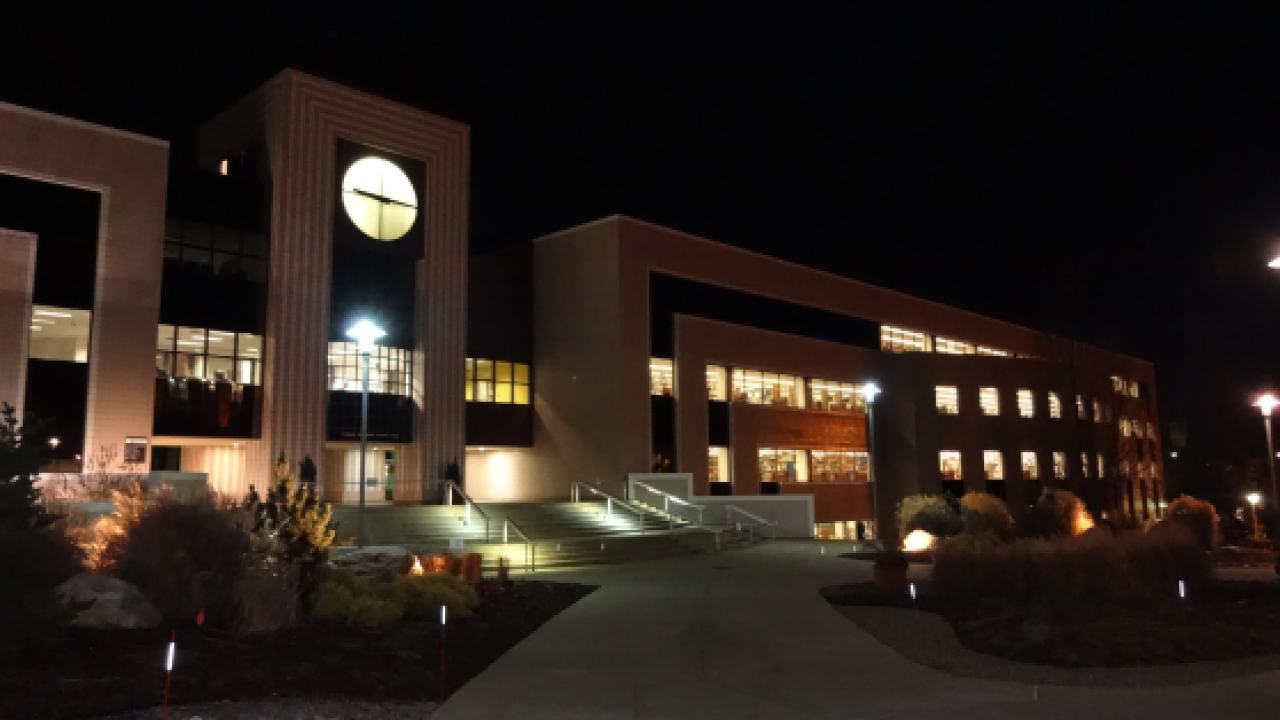 Outside Waldo Library building at night.