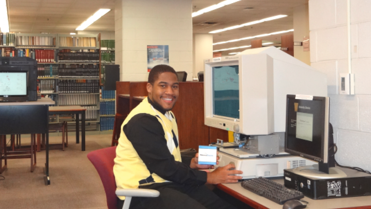 Student employee operating microform reader