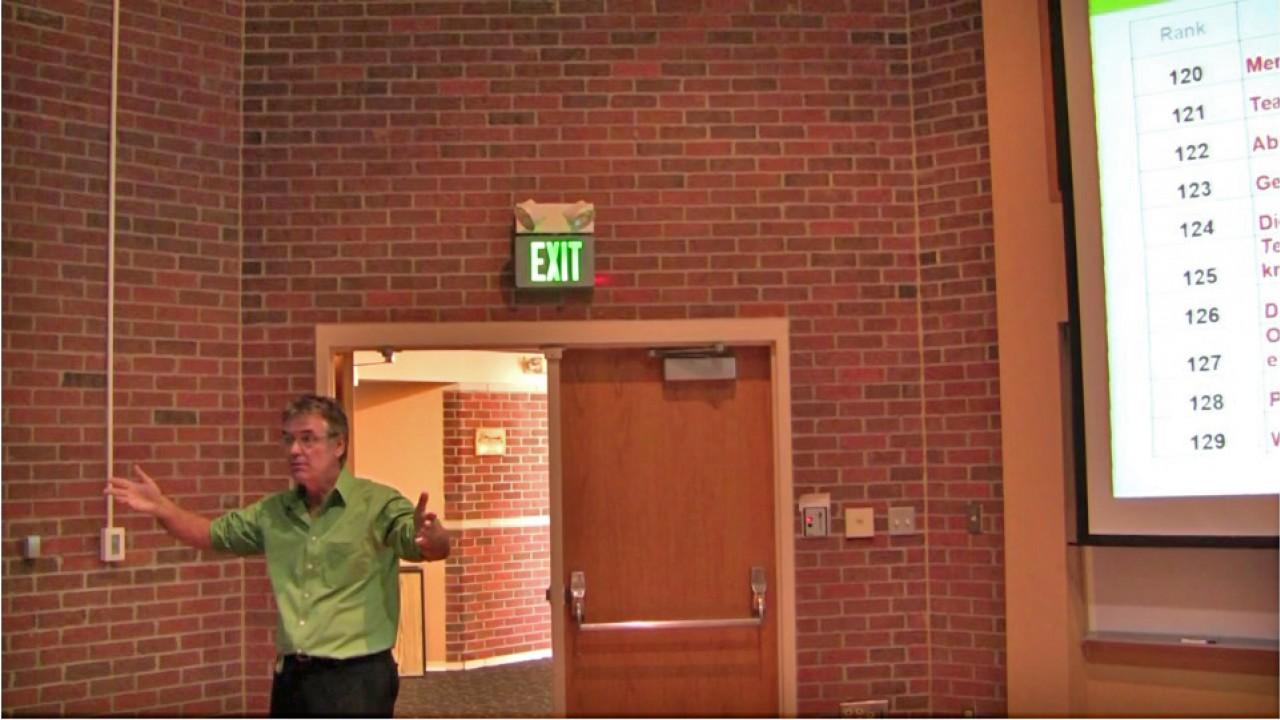 Dr. John Hattie giving presentation.