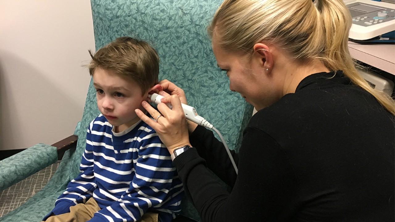 Student clinician examining child
