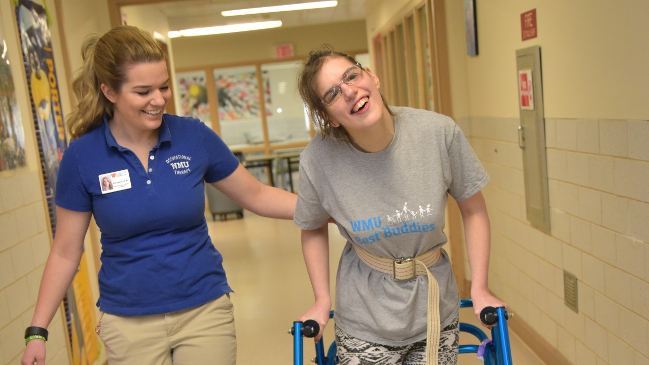 OT student assisting young lady