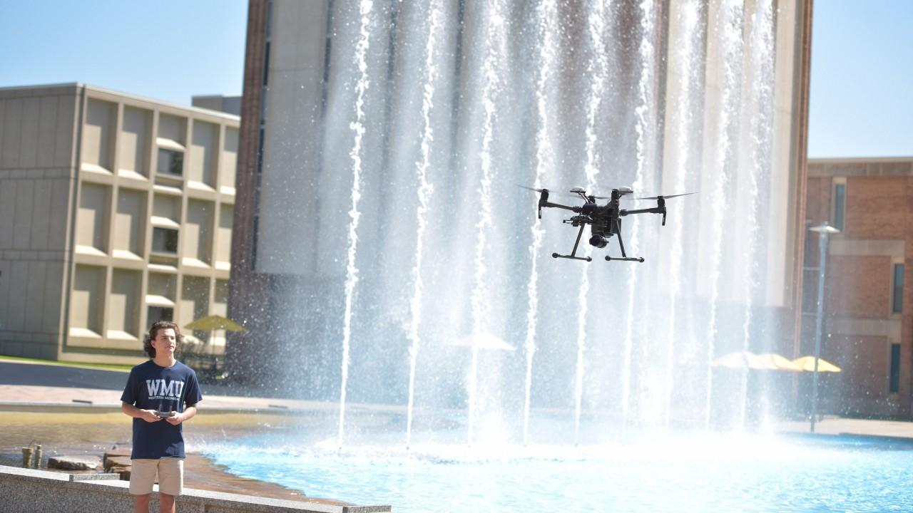 UAV flying in front of Miller Auditorium