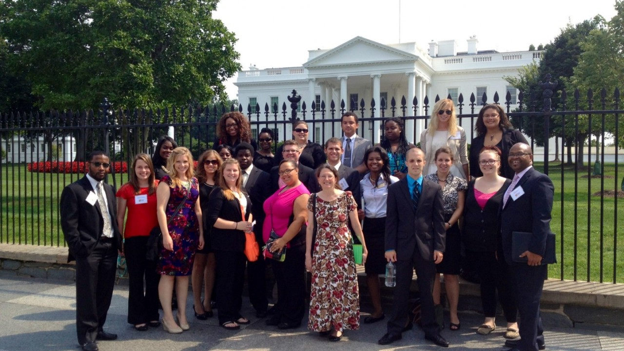 Group of staff and students standing in front of the White House.