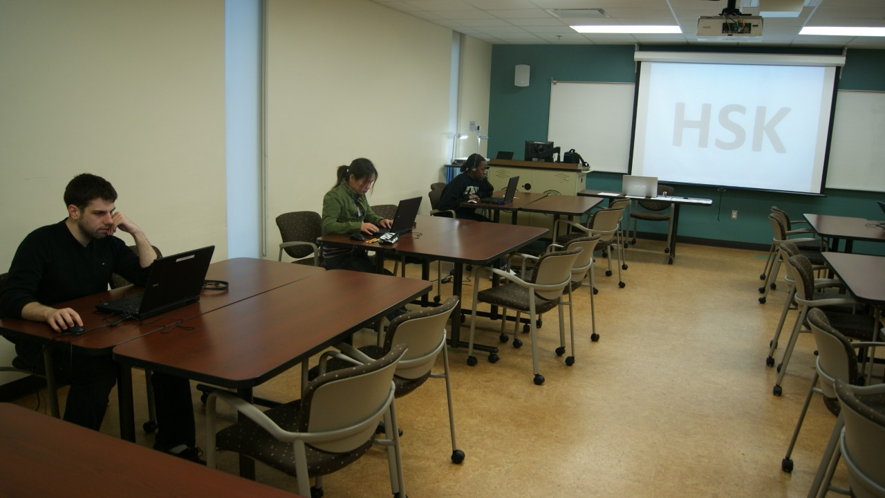Students focus on their HSK Chinese proficiency test, hosted by the Confucius Institute at WMU.