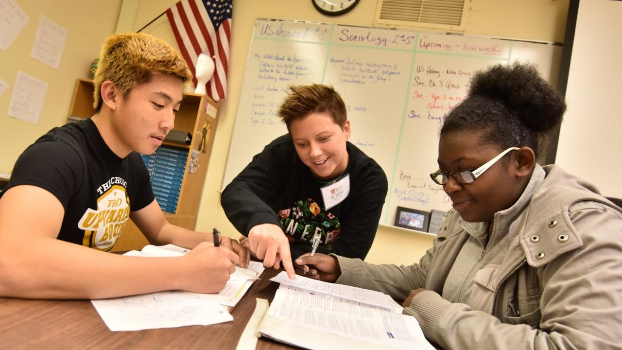 Two students being tutored through Upward Bound's tutoring program