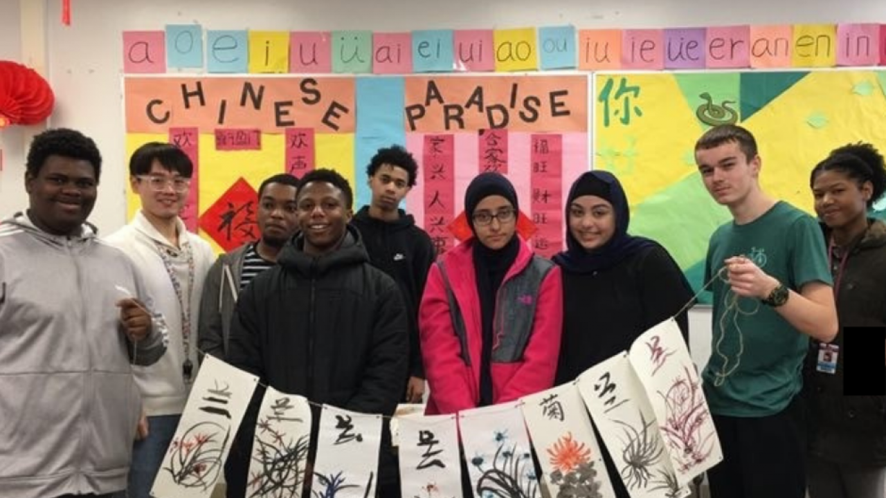 Kalamazoo Central High School students display their Chinese painting with the teacher