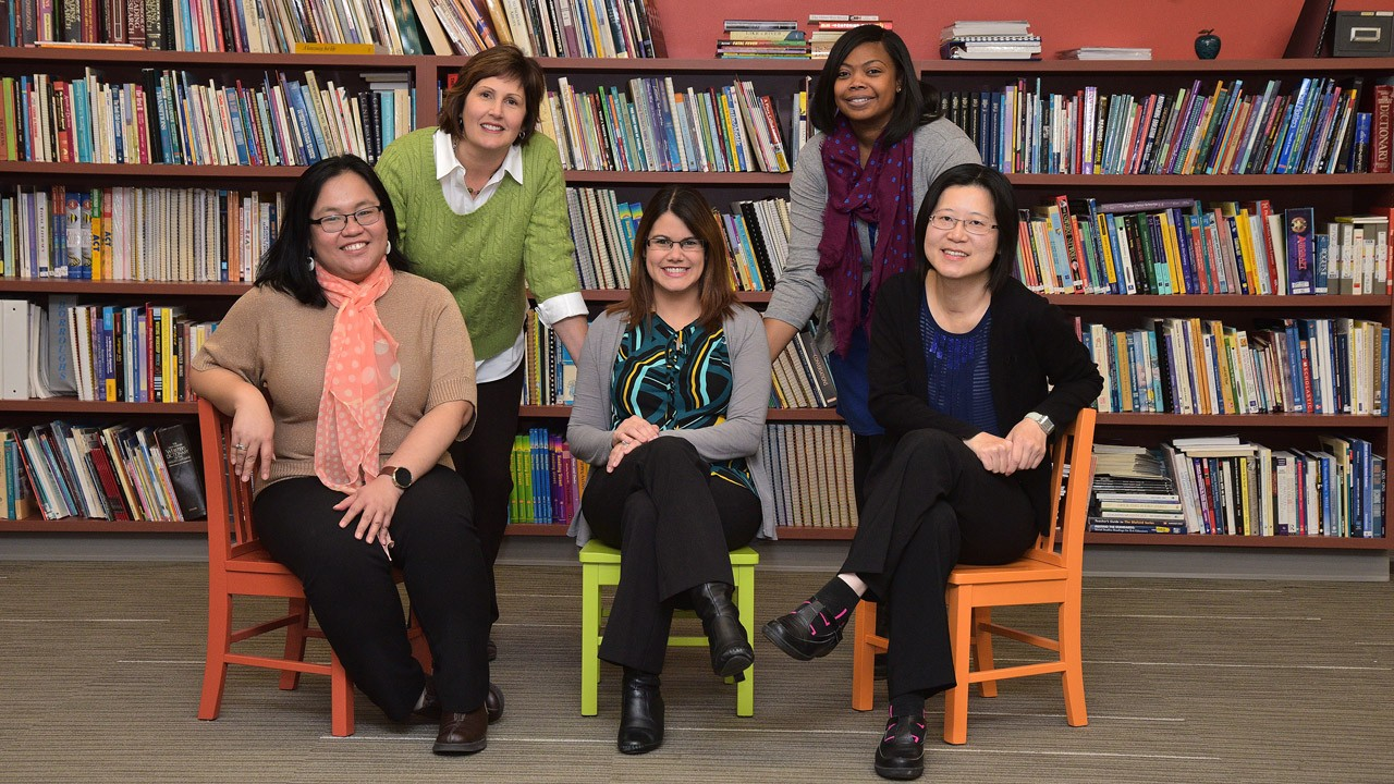 staff posing in the library