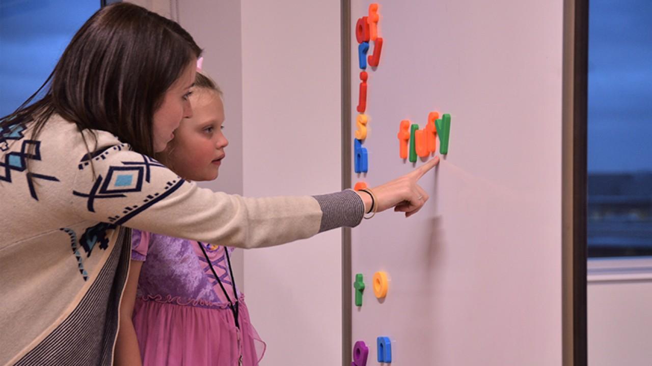 little girl learning in the reading center