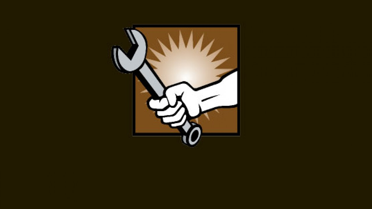 Hand holding wrench with an explosion behind it.