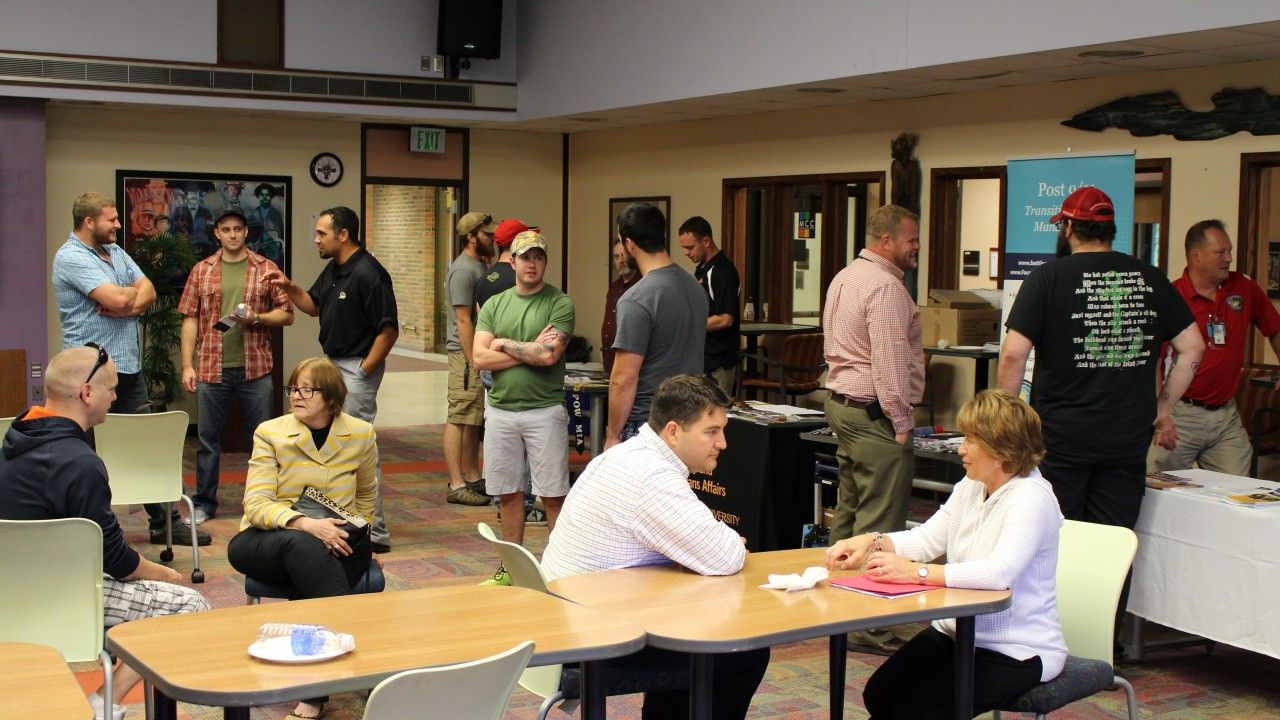 A large group of students and staff participating in an orientation session