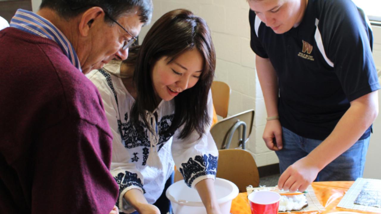 Students making sushi