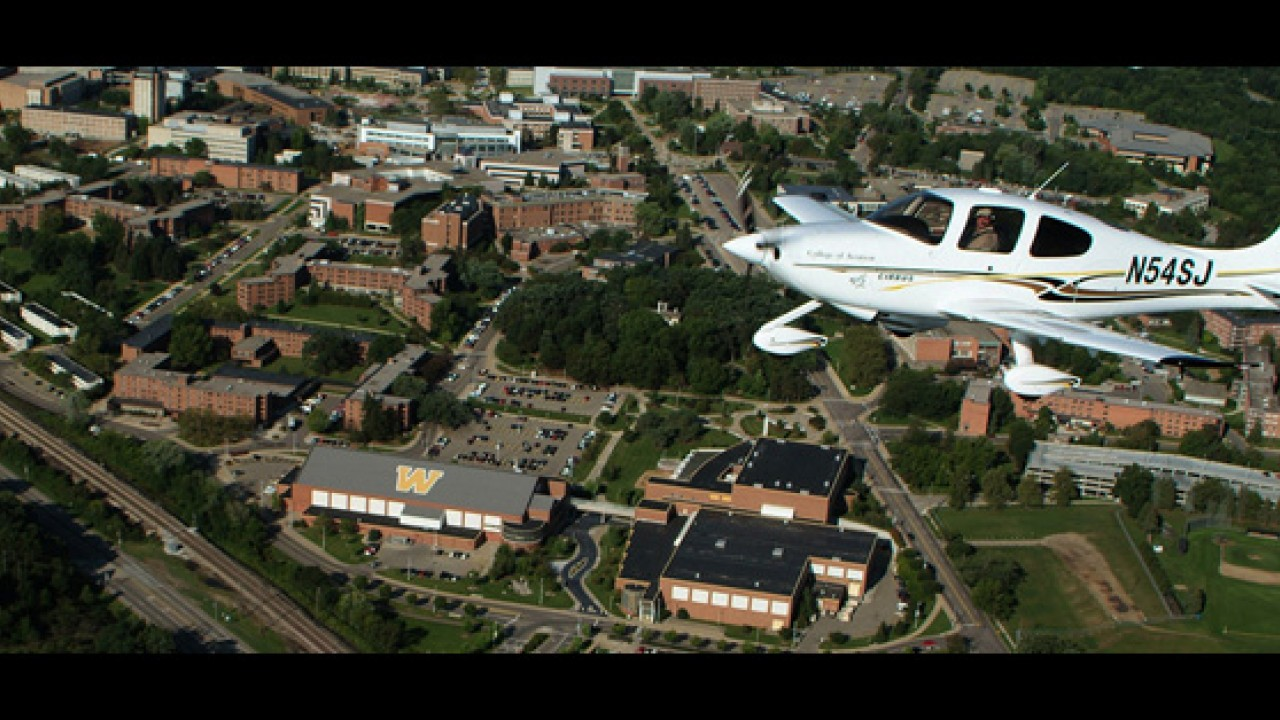 Sweet plane flying over main campus