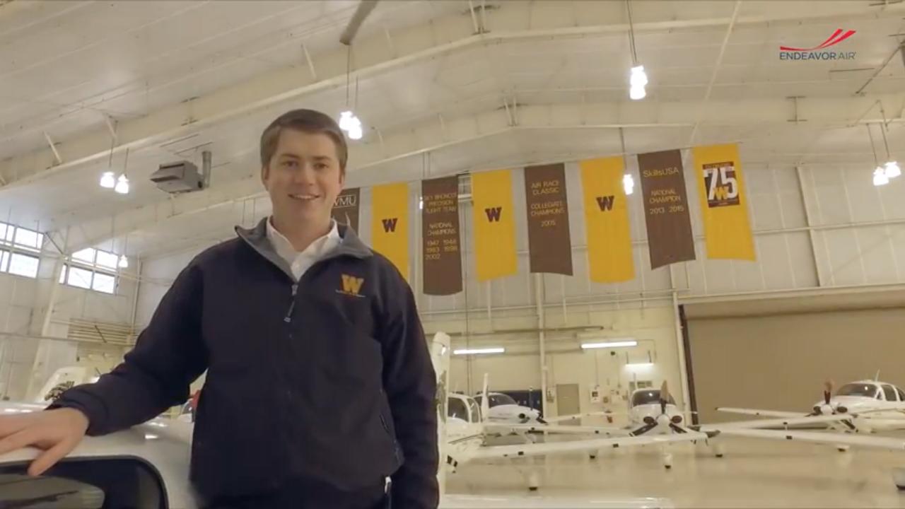 Ben Egan standing in a hanger