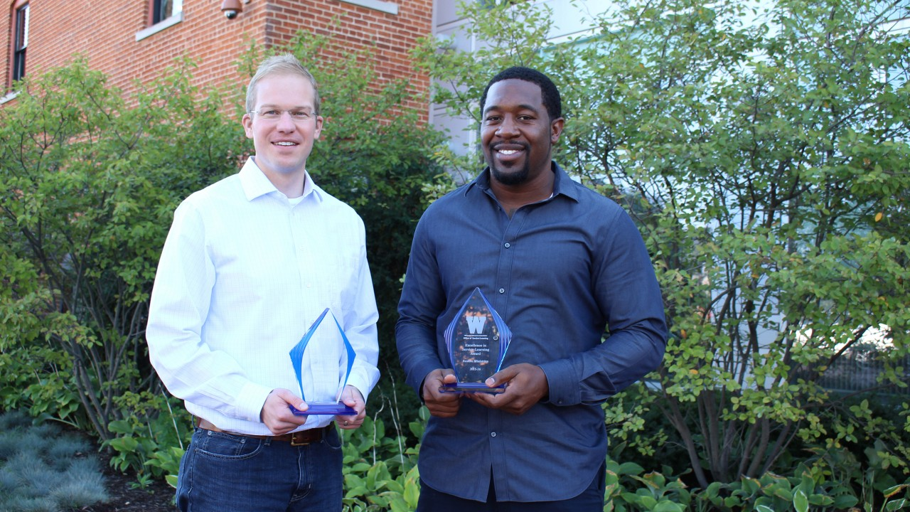 Recipients of the Excellence in Service-Learning awards: Dr. Brian Gogan and Marcus Collins of Restore Ministries