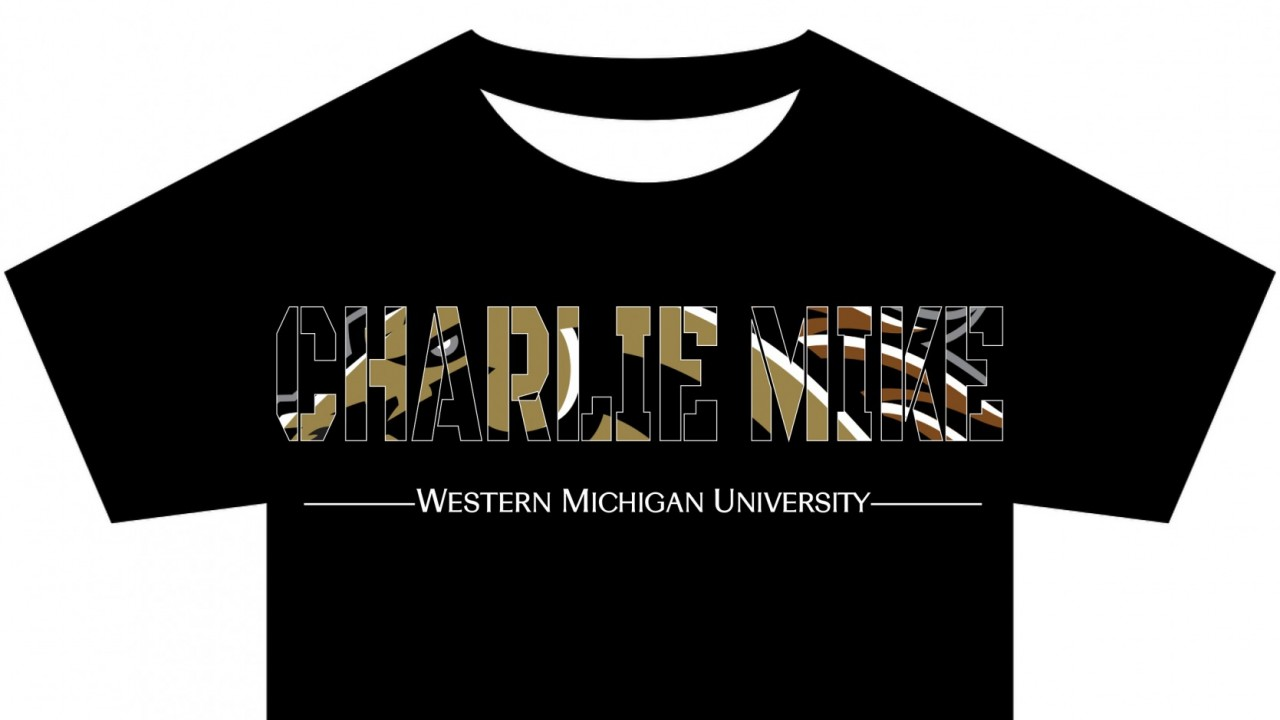 """A mock-up of our Charlie Mike t-shirt design. The shirt is black and features WMU's Bronco head logo hidden within the words, """"Charlie Mike""""."""