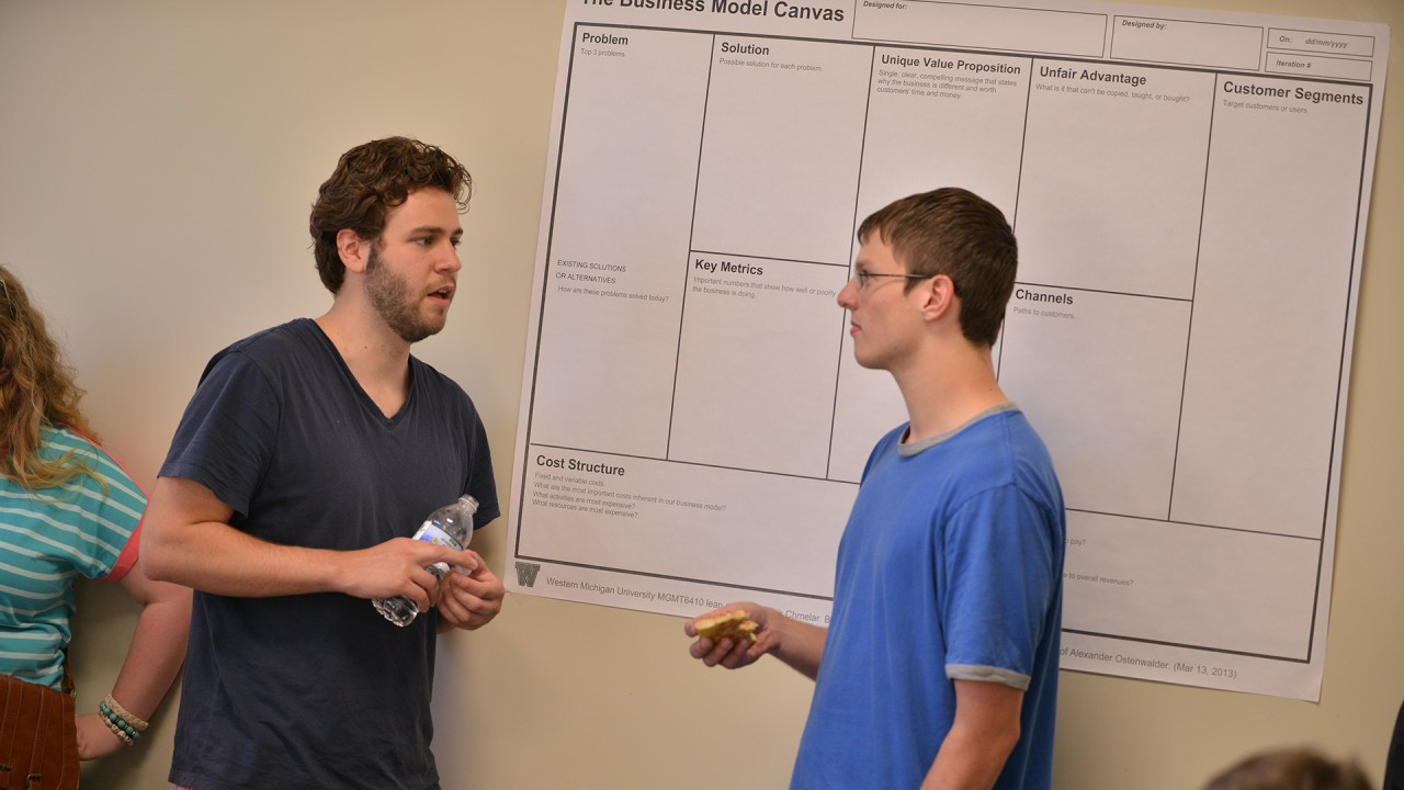 Photo of team members discussing schedules.