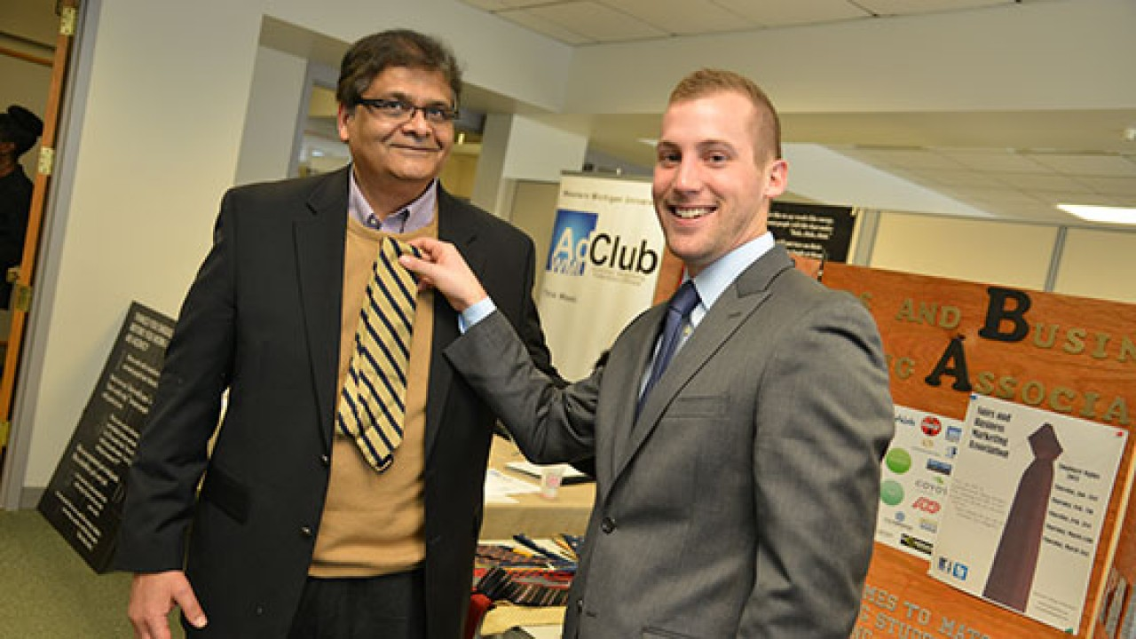 Photo of professor and student at Business Bash.
