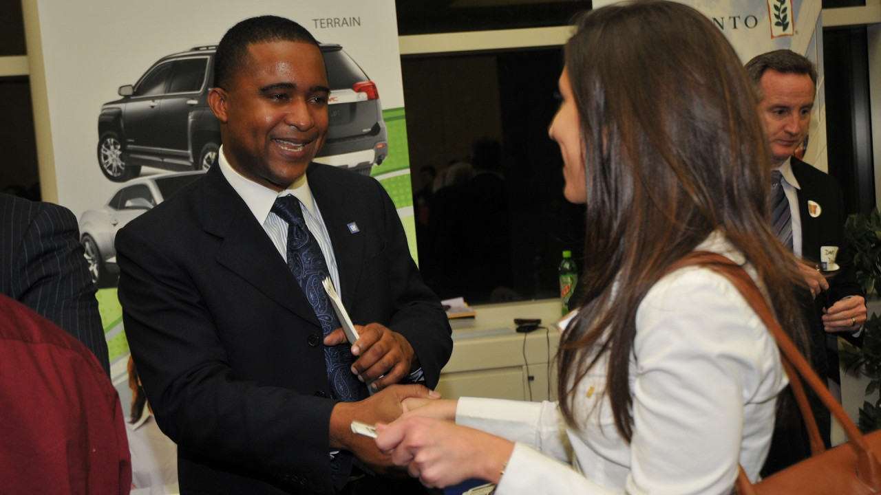 Photo of student and recruiter shaking hands